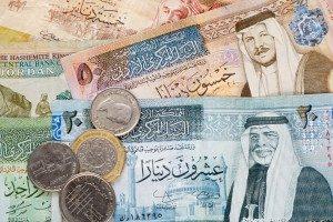 Jordanian dinar banknotes and coins background